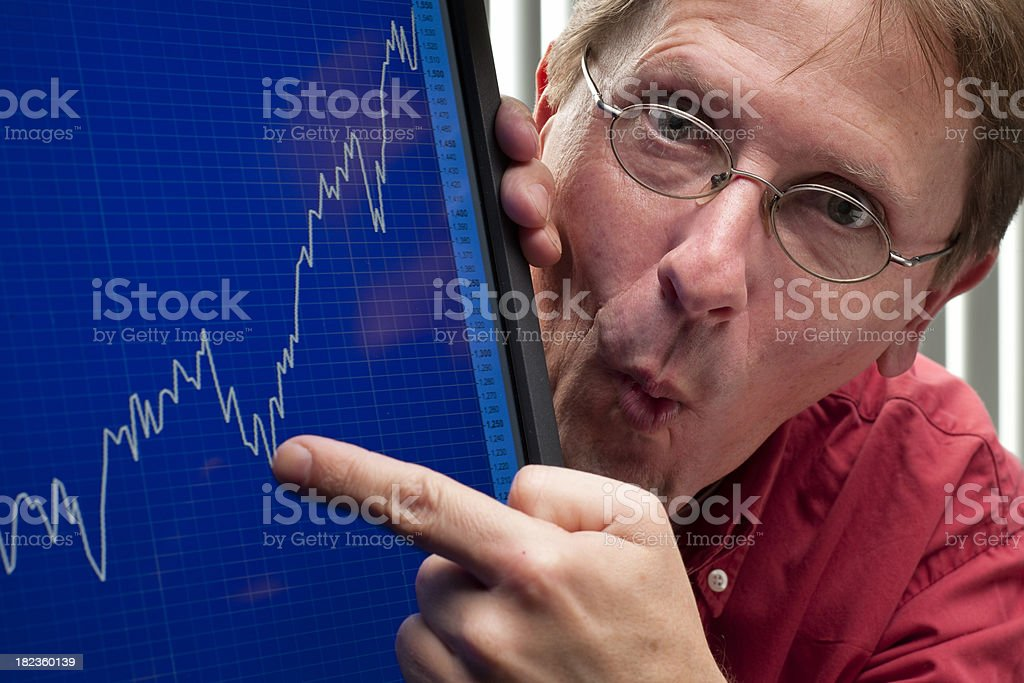 man pointing at positive stock exchange rate or company profit stock photo