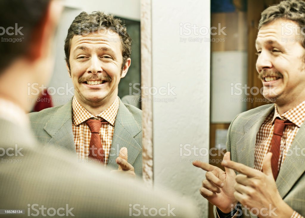 Man pointing at reflection in mirror stock photo