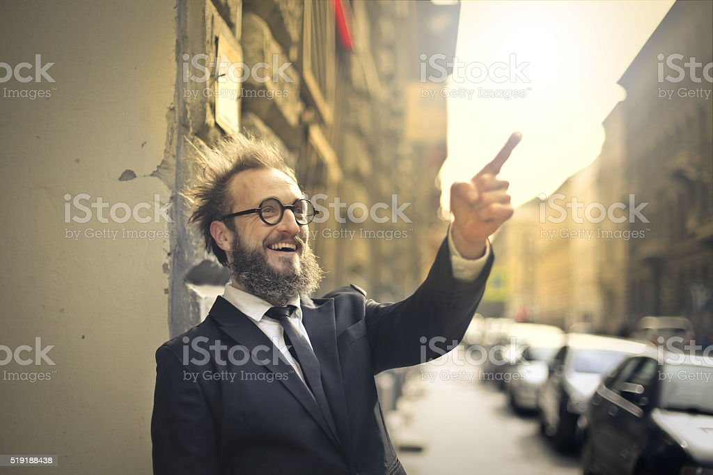 Man pointing at the street stock photo