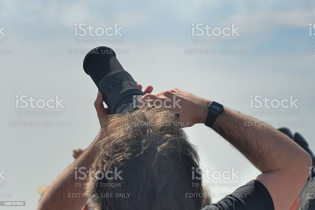 Man pointing Camera to sky at Clacton free  airshow 2016 stock photo