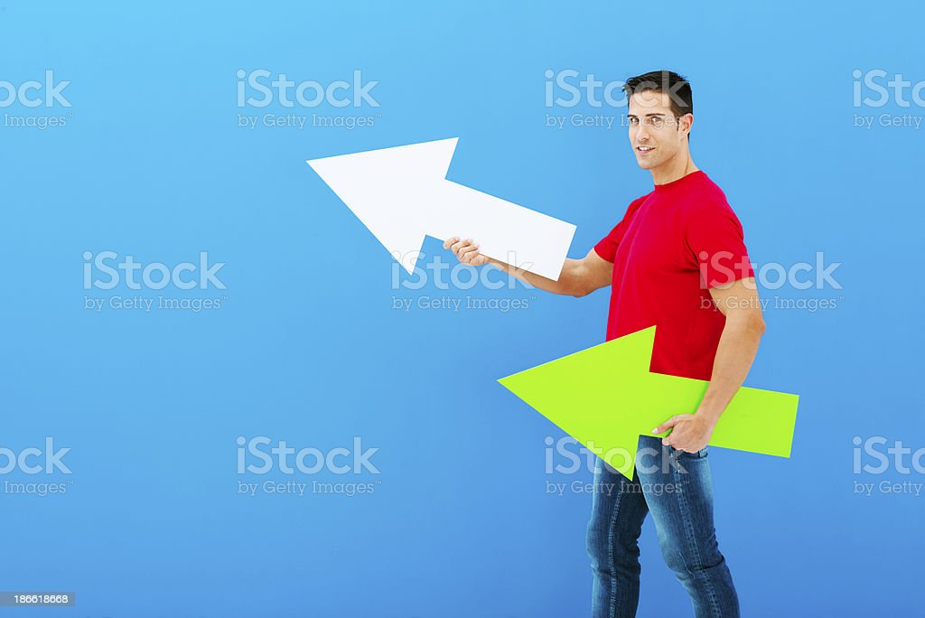 Man pointing forward with arrows stock photo