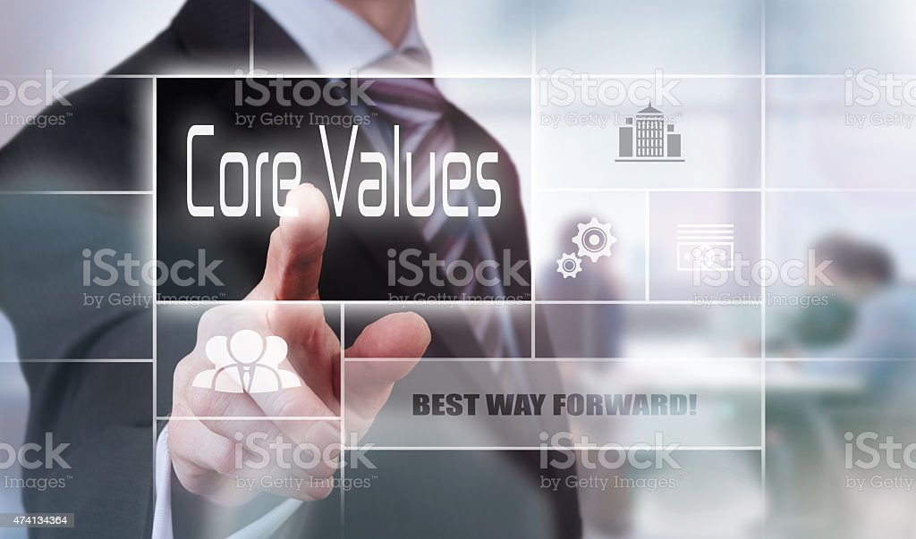 Man pointing his finger at the words core values stock photo