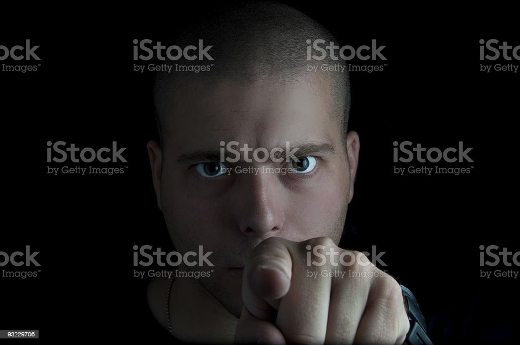 Man pointing in the dark. royalty-free stock photo