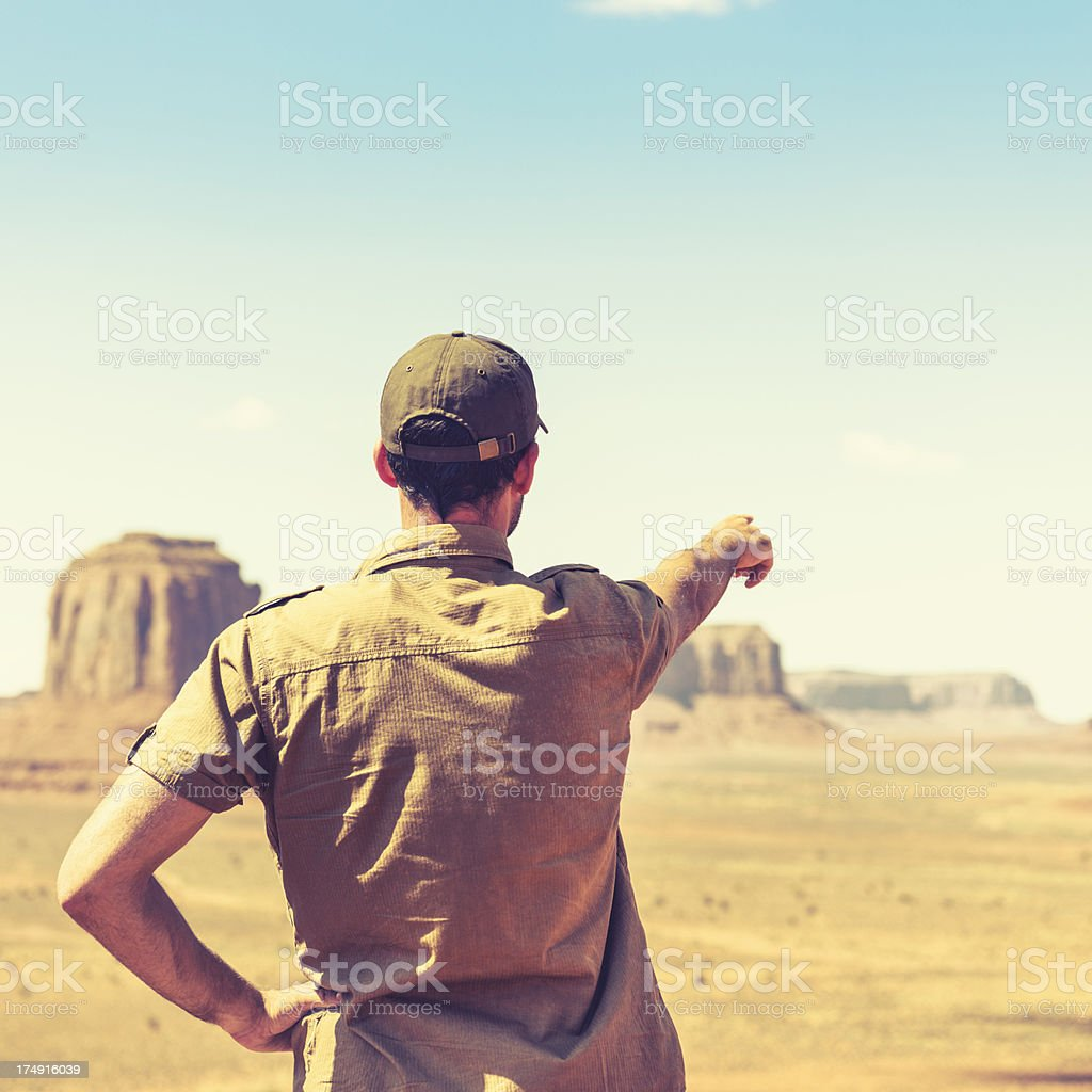 Man pointing out the landscape on Tribal National Park royalty-free stock photo