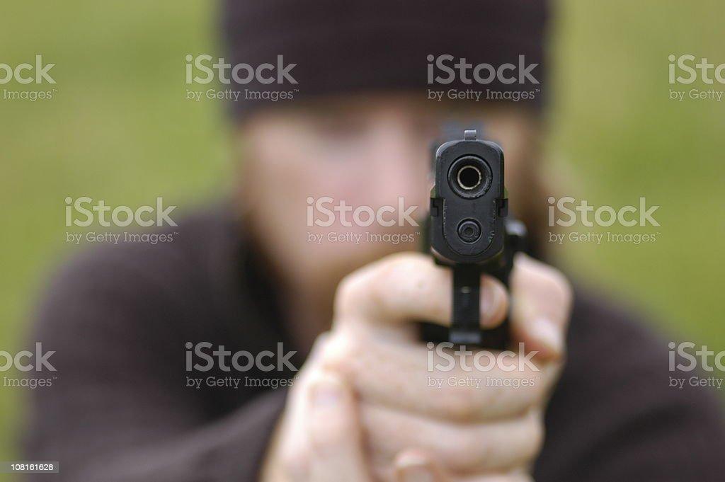 Man Pointing Pistol Straight Ahead royalty-free stock photo