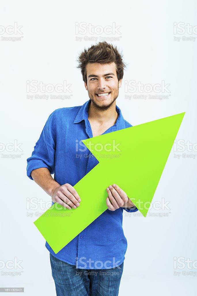 Man pointing right with green arrow stock photo