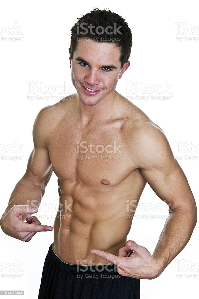 Man pointing to his abdominal muscles royalty-free stock photo