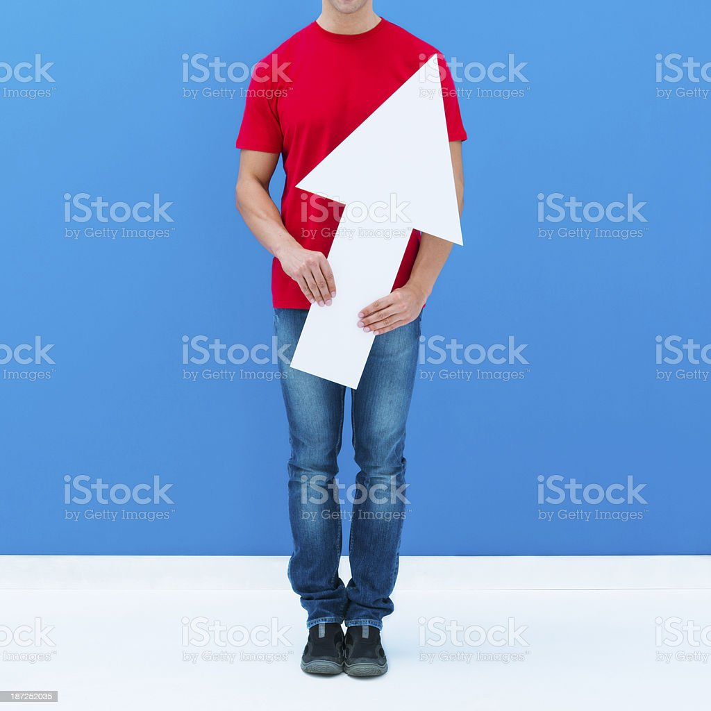 Man pointing up with arrow stock photo