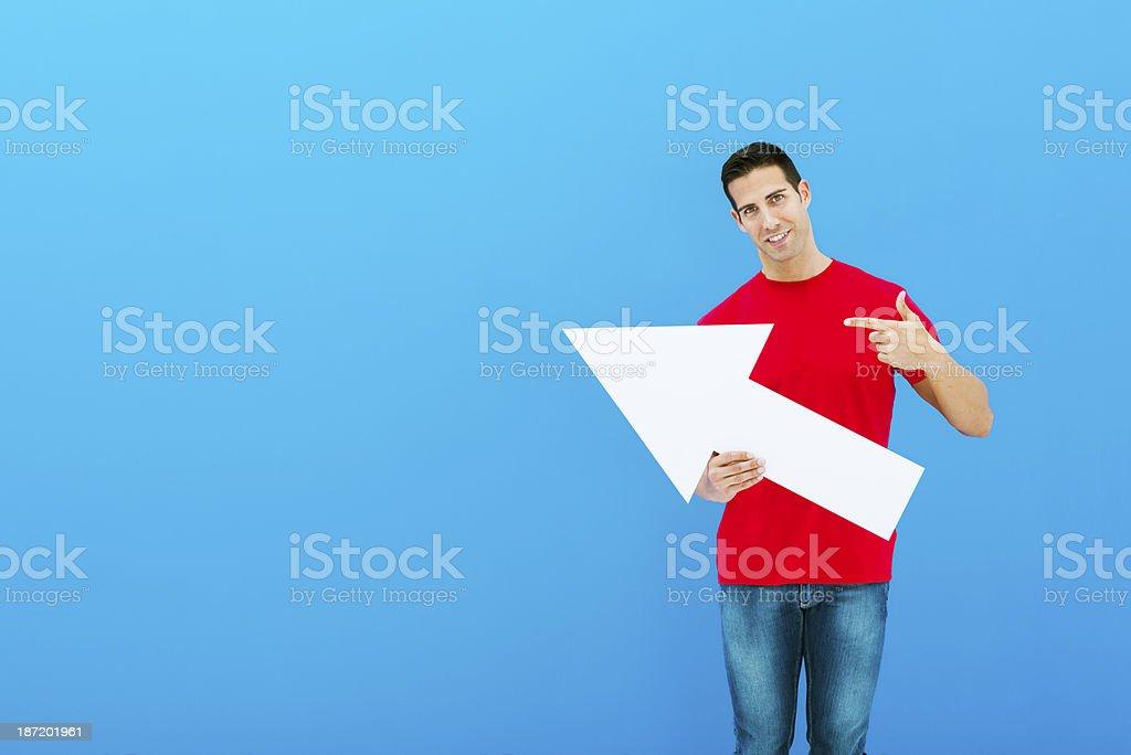 Man pointing with white arrow stock photo