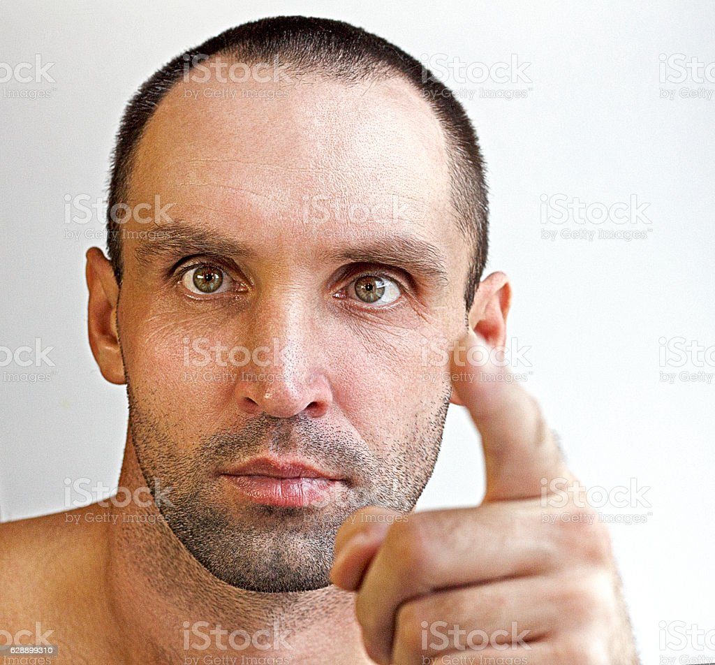 Man points a finger stock photo