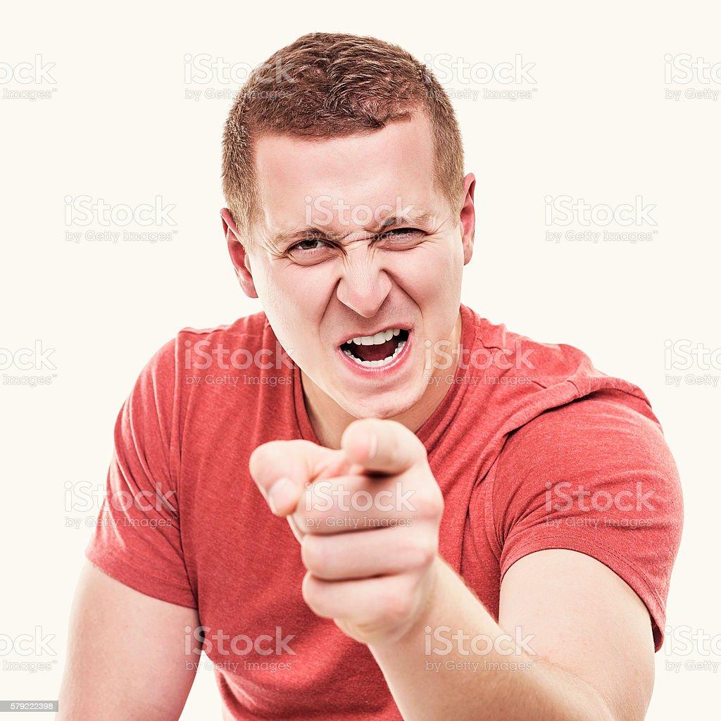 Man points his finger menacingly. stock photo
