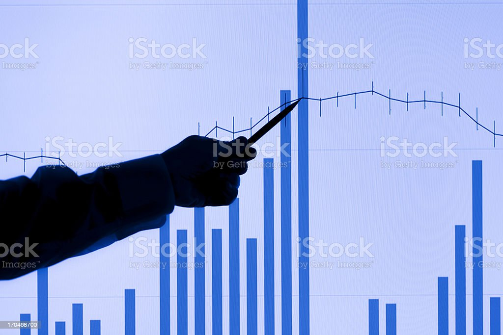 Man Points to Rising Chart royalty-free stock photo