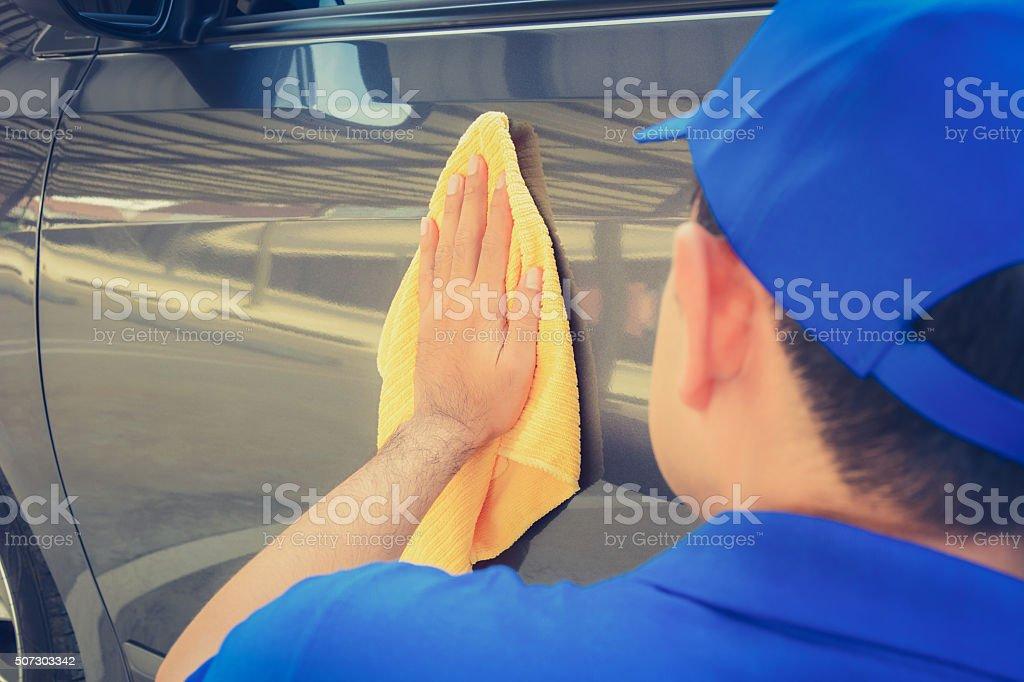 Man polishing car with microfiber cloth stock photo