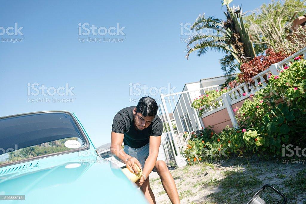 Man Polishing His Vintage Car With A Polishing Machine stock photo