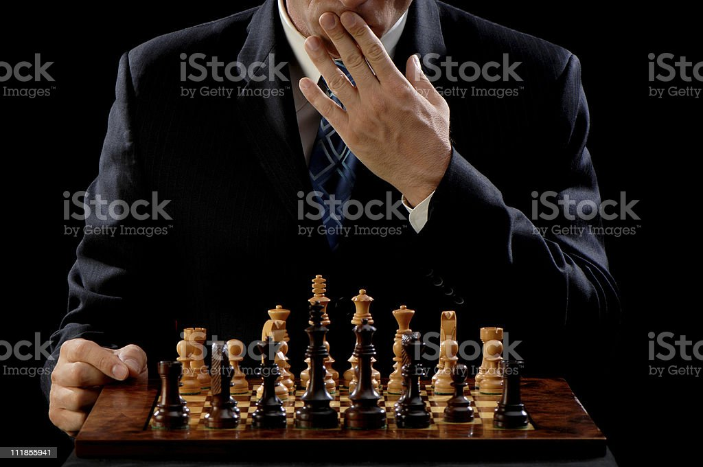Man Pondering Opening Move of Chess Game royalty-free stock photo