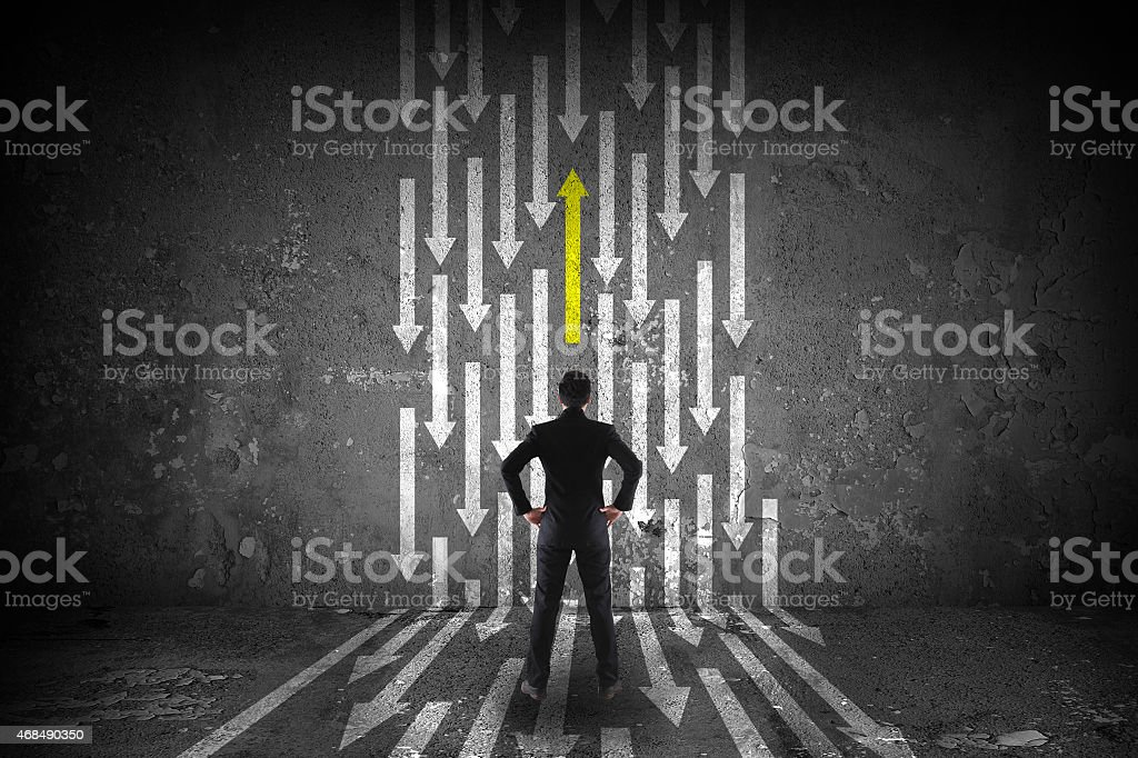 A man pondering witch path to take stock photo