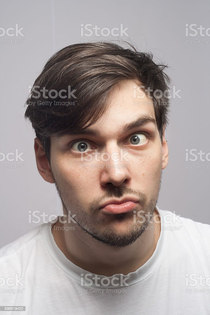 Man portrait, cross eyed, squint eyed, skew eye portrait. stock photo