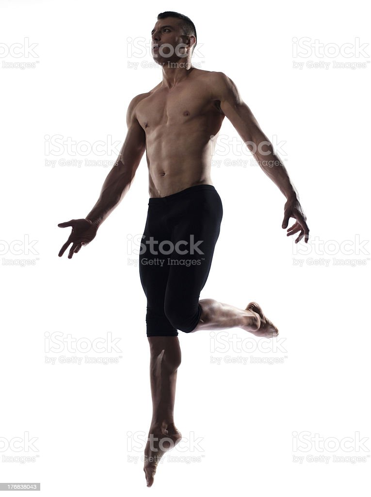man portrait gymnastic jump mid air position royalty-free stock photo