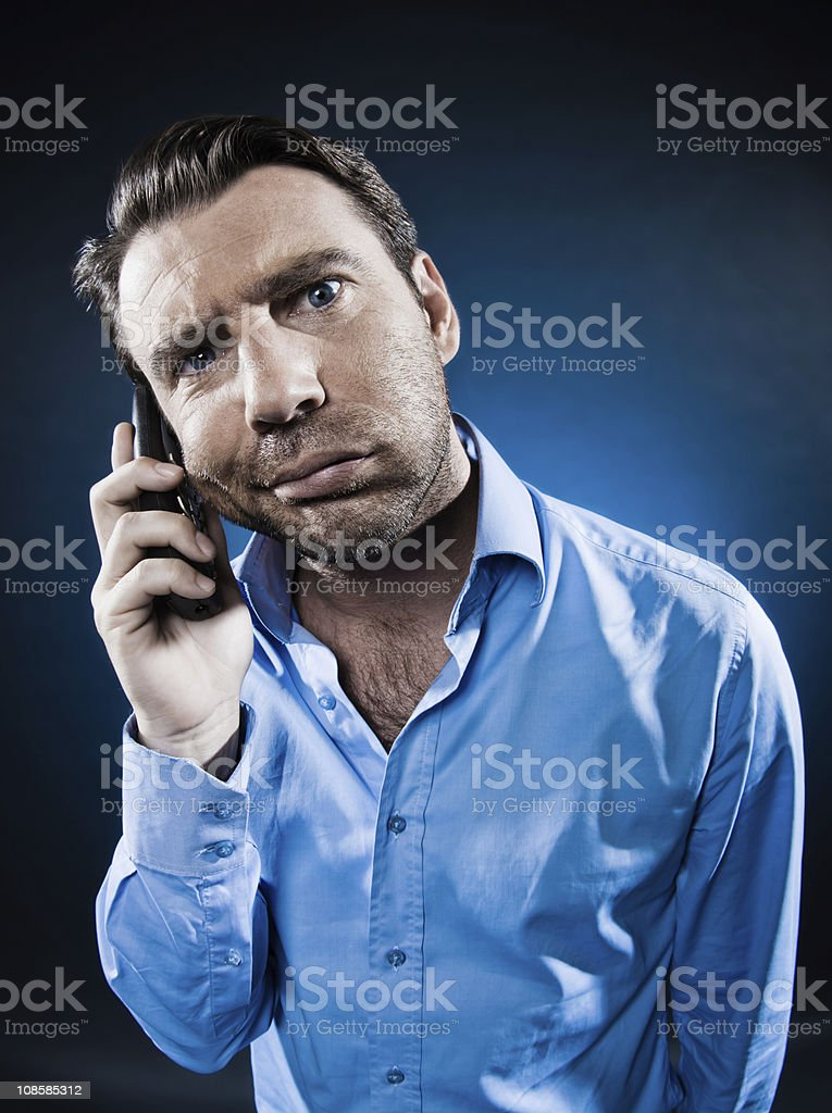 Man Portrait on the phone displeased royalty-free stock photo