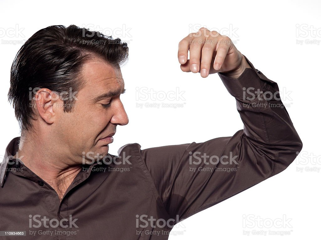 Man Portrait sweat perspiring armpit stained shirt stock photo