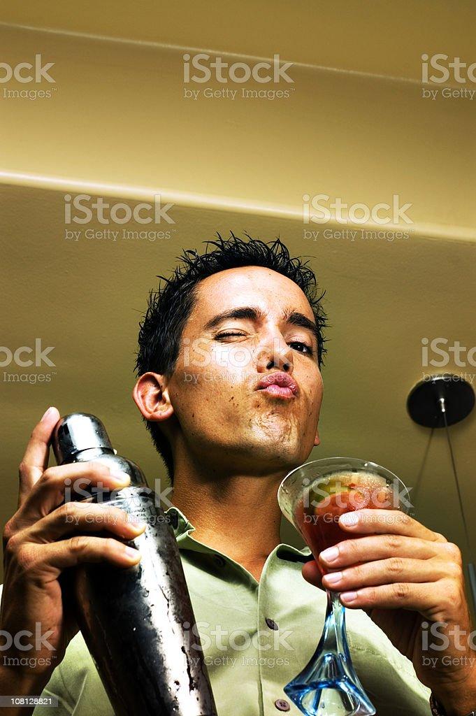 Man Posing and Holding Martini Mixer royalty-free stock photo