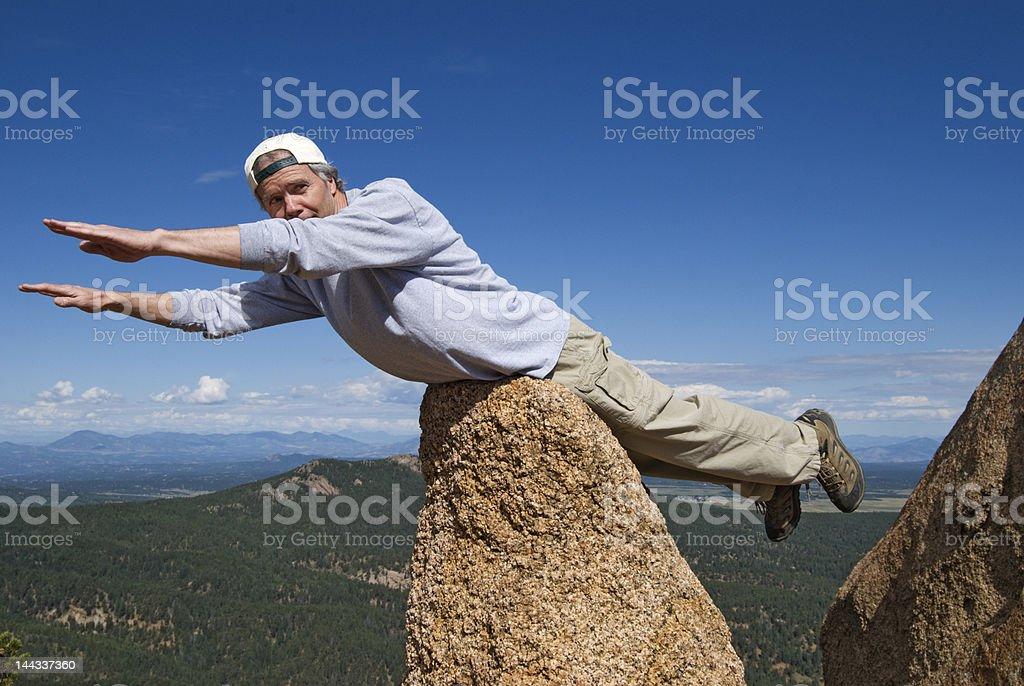 Man Posing as Flying Superman stock photo