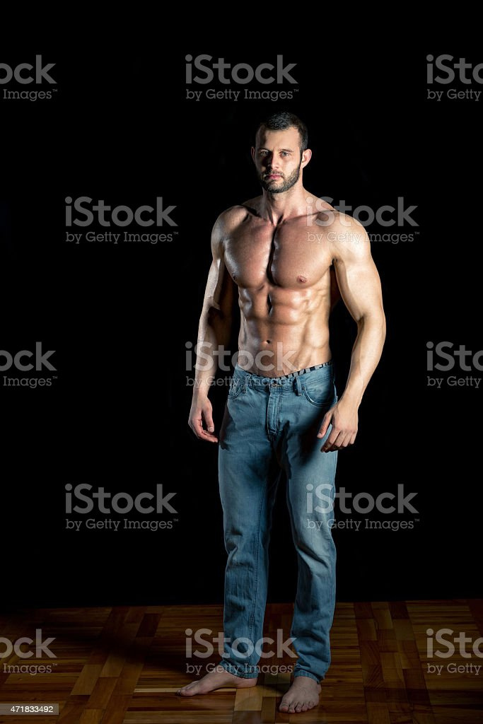 Man posing in jeans stock photo