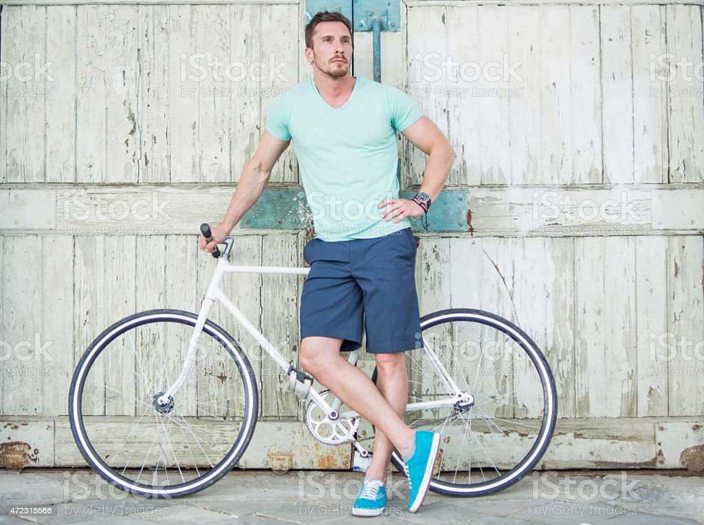 Man posing with bicycle stock photo