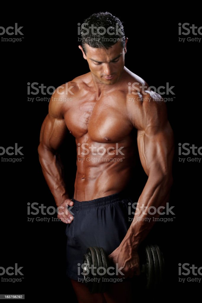 Man Posing With Dumbbell royalty-free stock photo