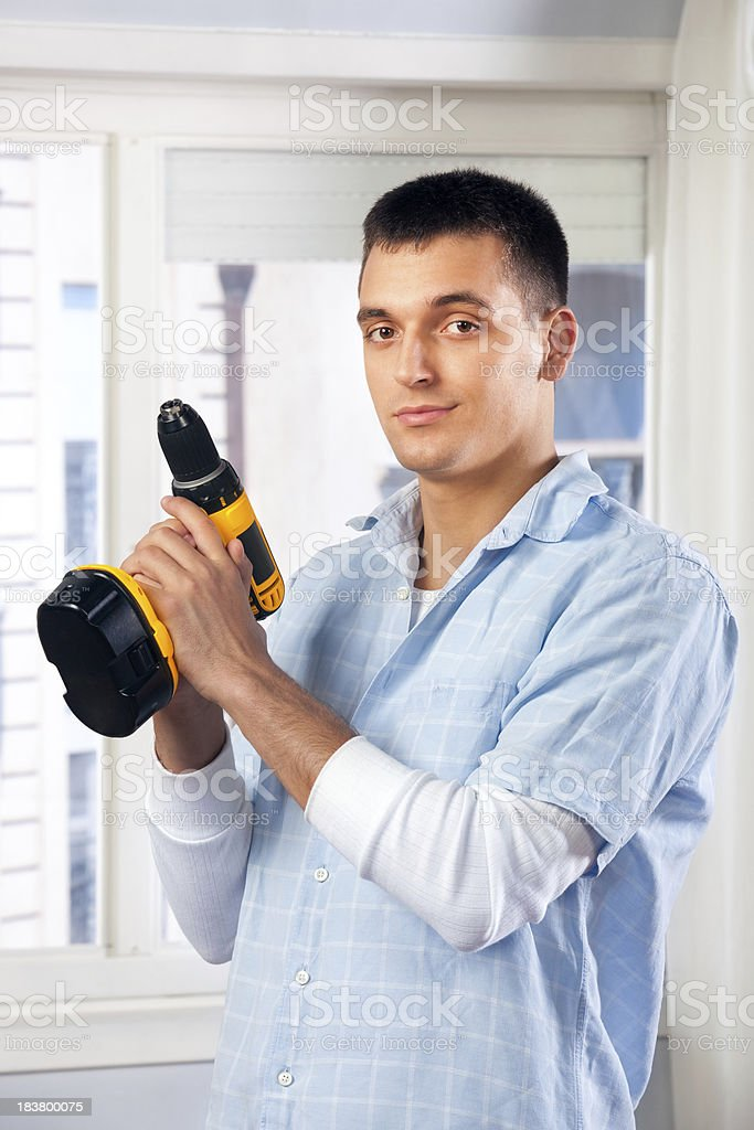 Man posing with electric drill royalty-free stock photo