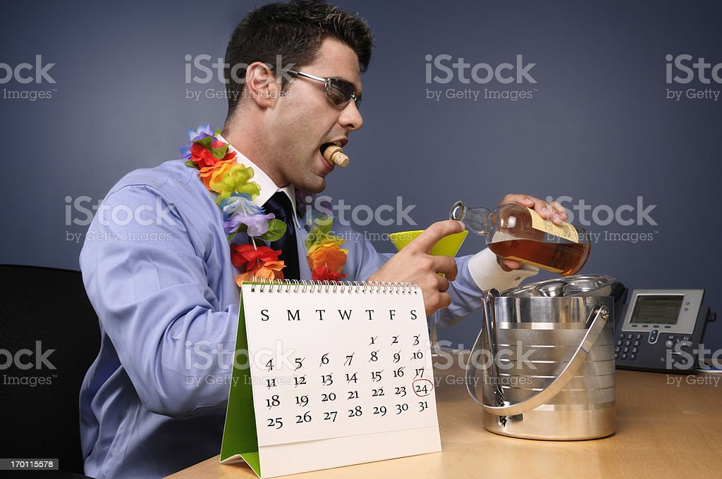 Man pouring drink in office royalty-free stock photo