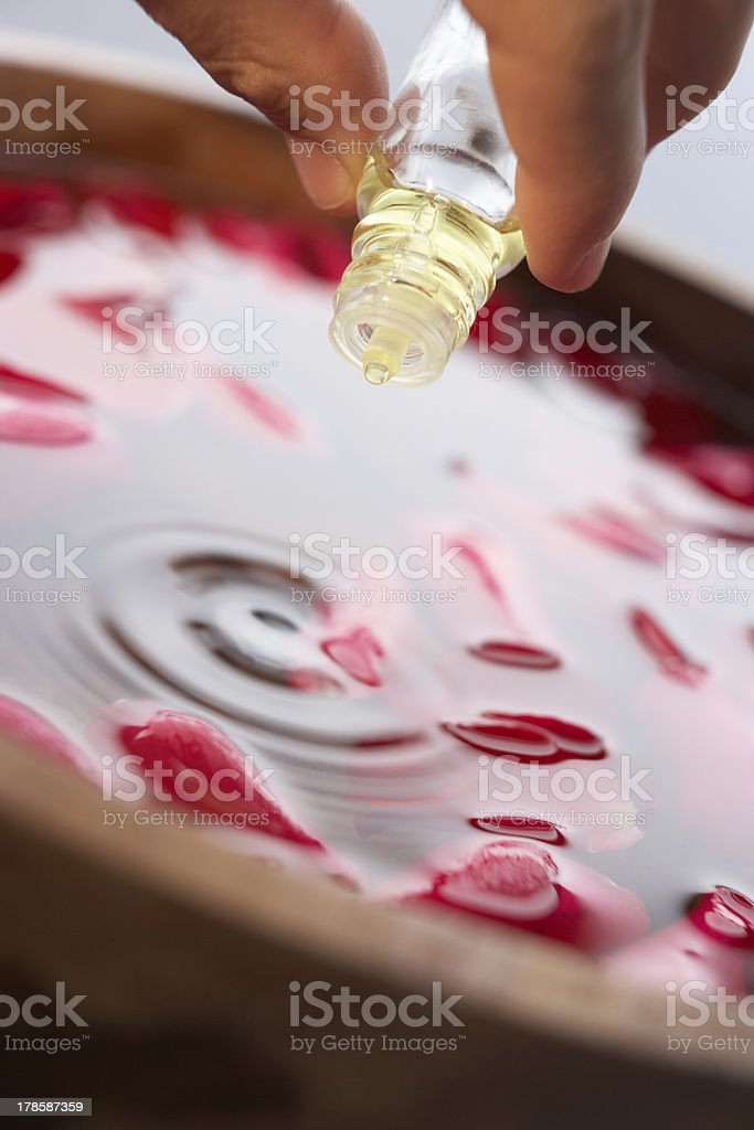 Man pouring essential oil into water stock photo