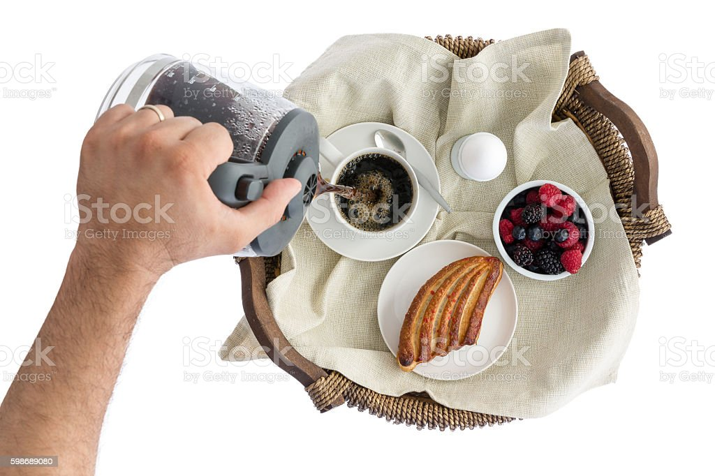 Man pouring fresh breakfast coffee stock photo