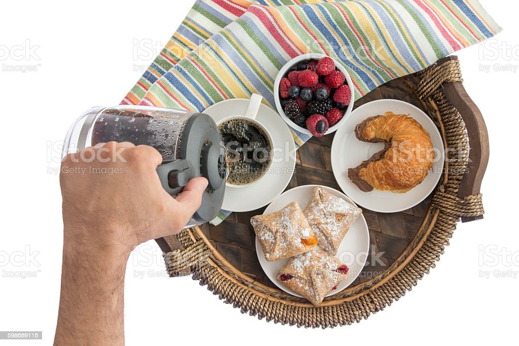 Man pouring fresh coffee for his breakfast stock photo