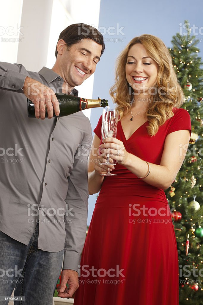 Man Pouring Holiday Campagne royalty-free stock photo