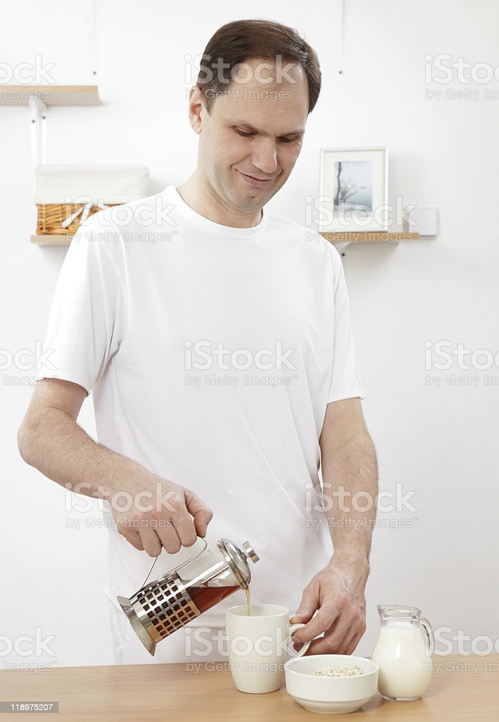 Man pouring tea for breakfast royalty-free stock photo