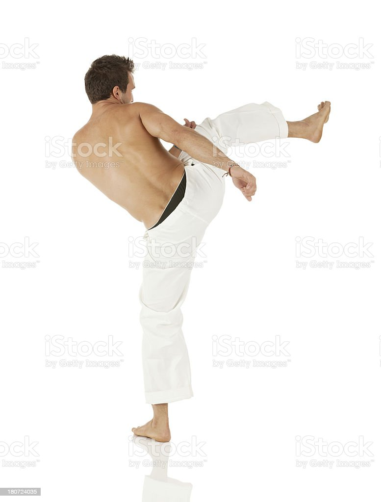 Man practicing capoeira royalty-free stock photo