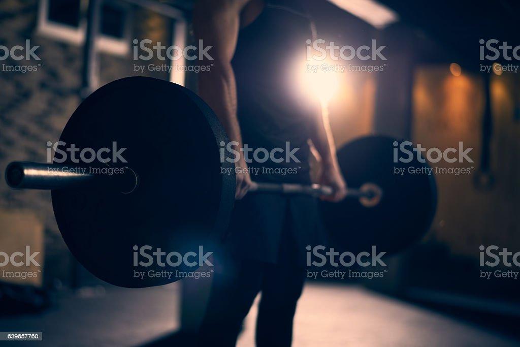 Man practicing deadlifts stock photo