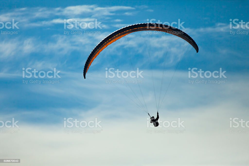 Man practicing paragliding extreme sport stock photo