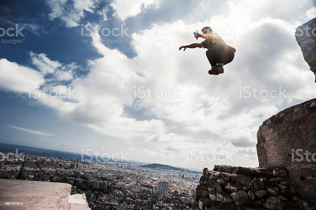 Man practicing parkour in the city of Barcelona stock photo