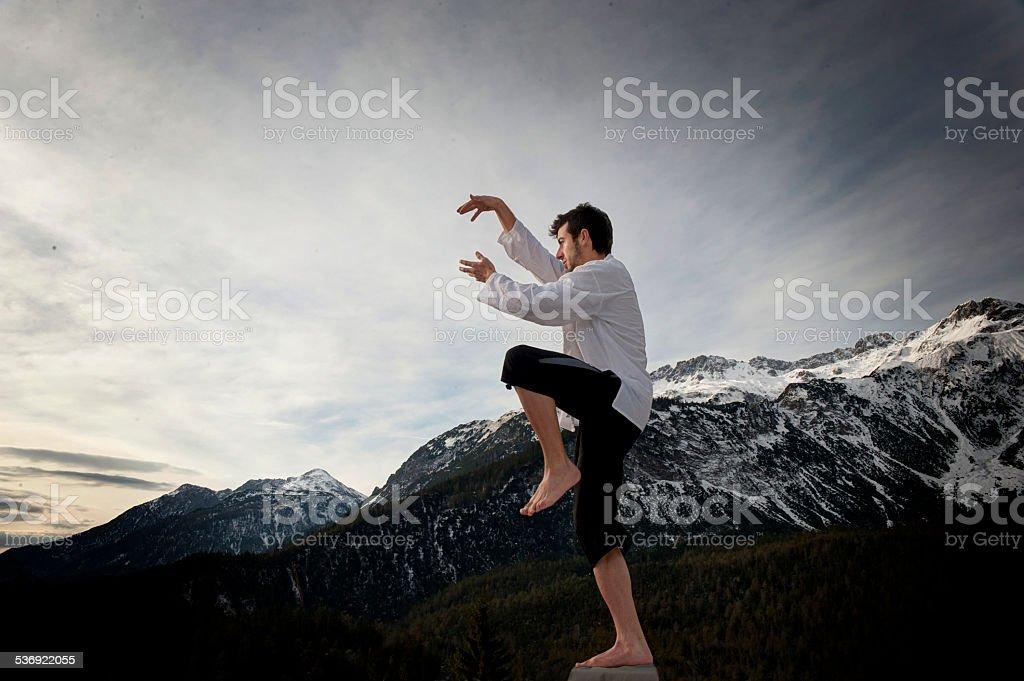 Man practicing Tai Chi, Yoga and Qi Gong stock photo