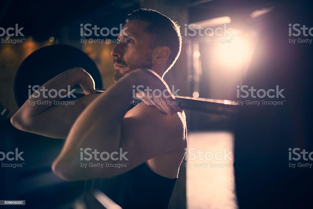 Man practicing weight lifting stock photo