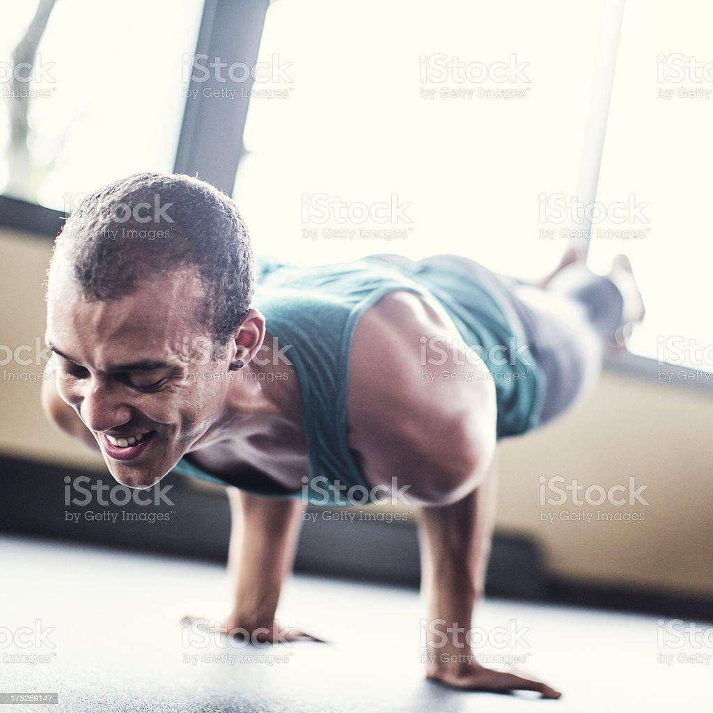 Man Practicing Yoga in Bright Studio royalty-free stock photo