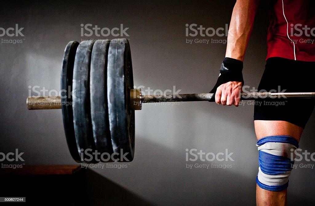 Man practising weightlifting III stock photo