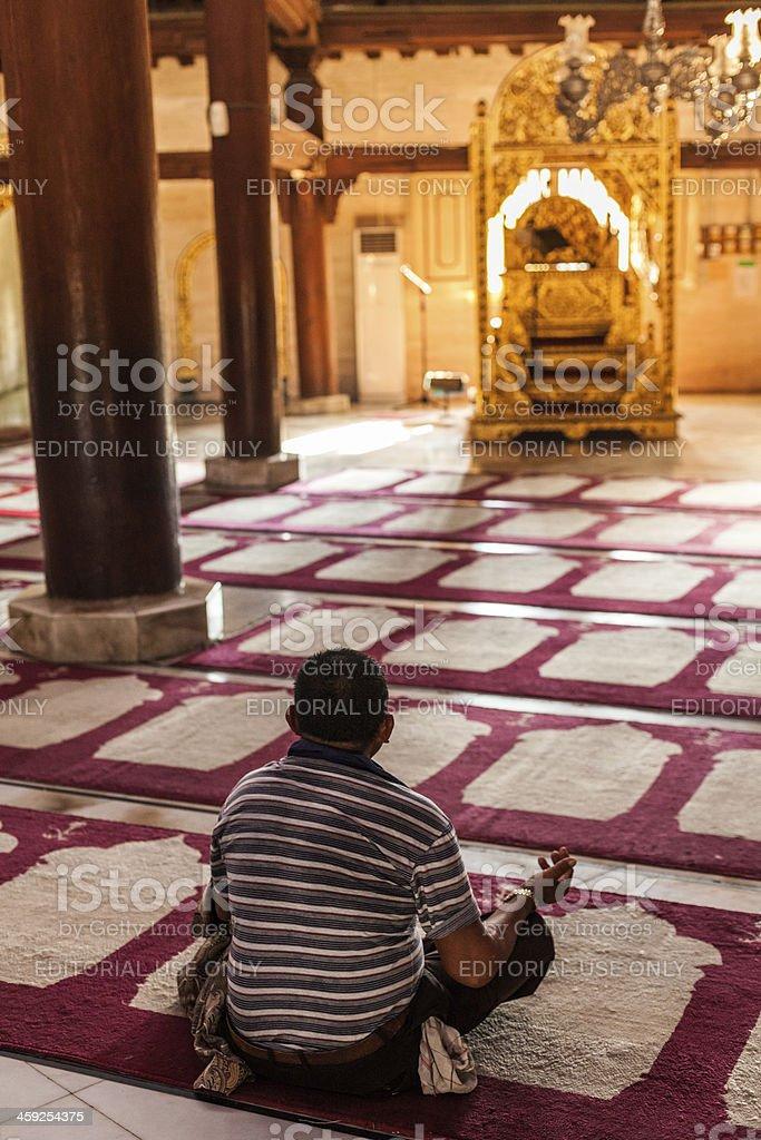 Man Praing in the Sultan's Mosque of Yogyakarta, Indonesia stock photo