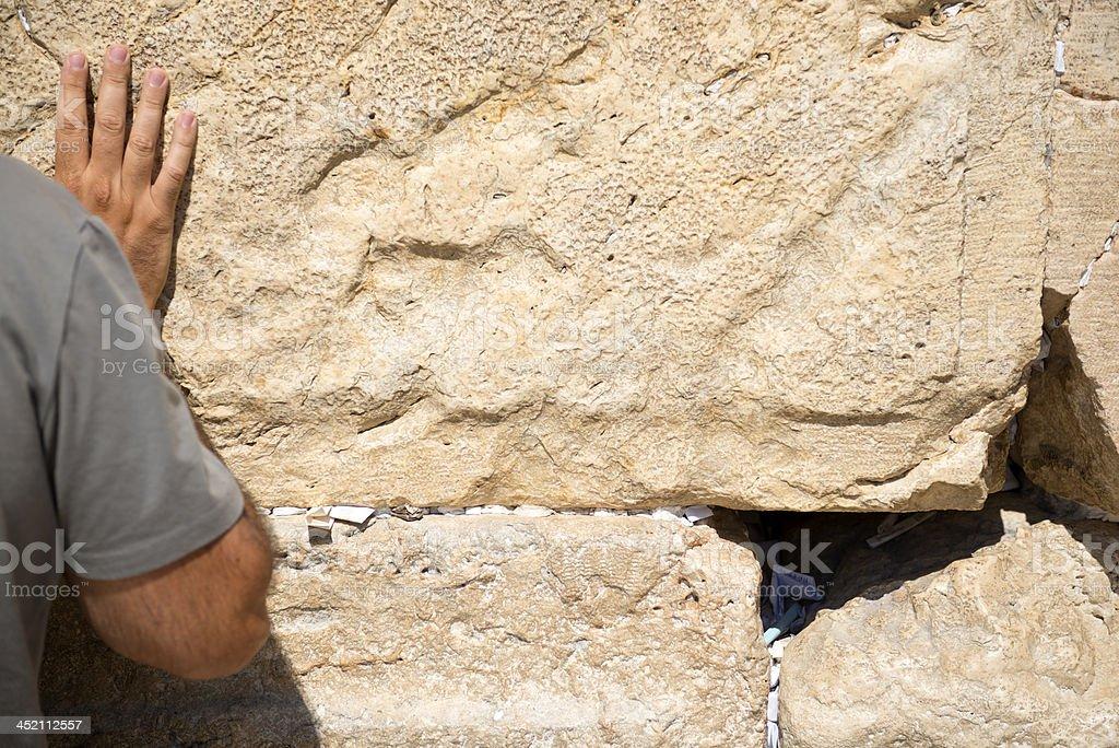 Man praying at Jerusalem's Western Wall royalty-free stock photo