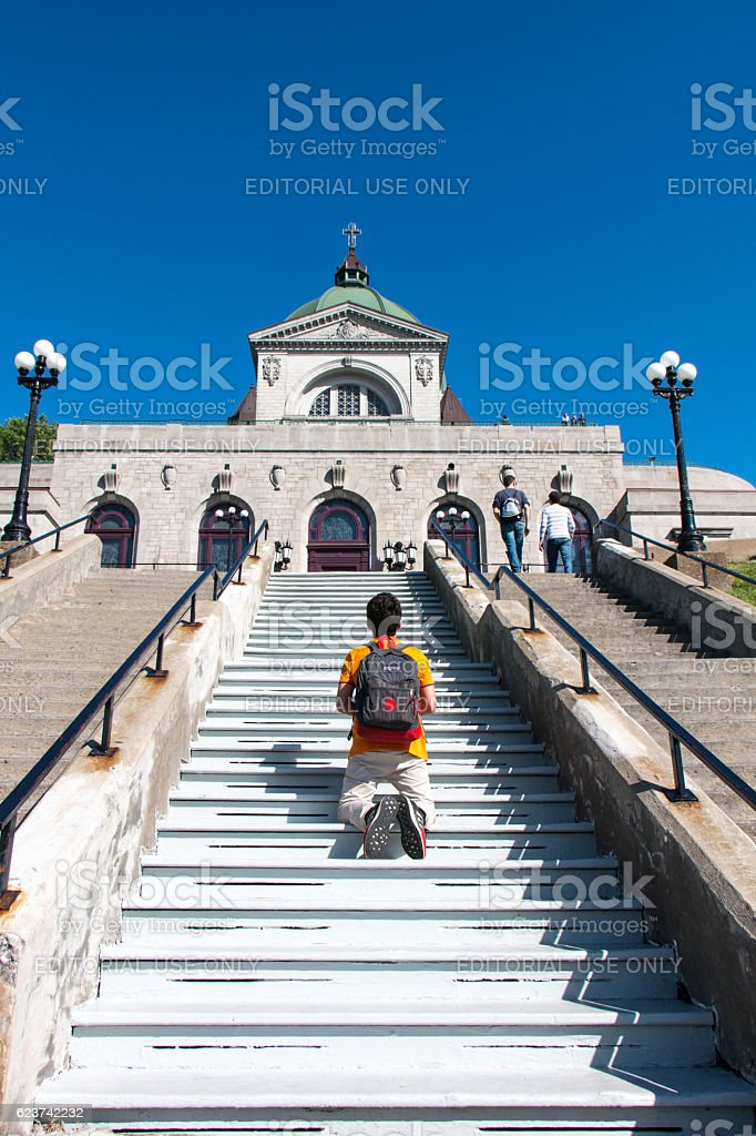 Man praying at Saint Joseph's Oratory of Mount Royal stock photo