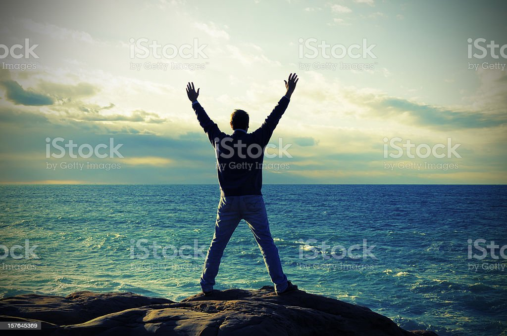 Man Praying by the Sea royalty-free stock photo
