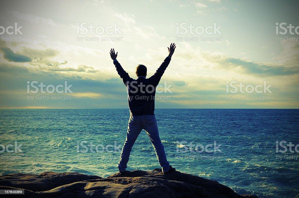 Man Praying by the Sea stock photo