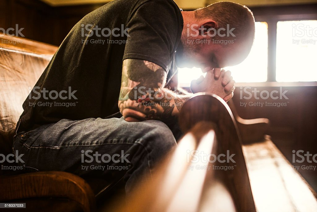 Man Praying in Church stock photo